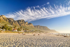 Evening at Camps Bay Beach - Cape Town, South Africa. Stunning evening XXL panorama of Camps Bay, an affluent suburb of Cape Town, Western Cape, South Africa Royalty Free Stock Images