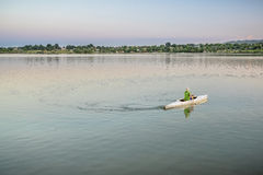 Evening canoe paddling in Colorado Royalty Free Stock Image
