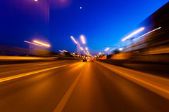 In the evening, the car driving on the highway Stock Photos