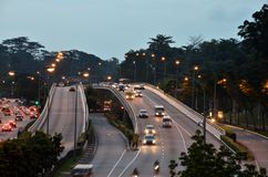 Evening car traffic with headlights on flyover Stock Photography
