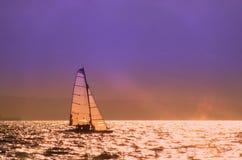 Evening Catamaran. A catamaran sailing on the north coast of Ireland Stock Images