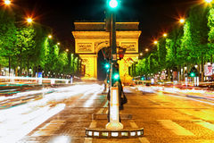 Evening on Champs-Elysees in front of Arc de Triomphe.Paris. Fra Royalty Free Stock Photography