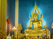 Evening chant in Marble temple. BANGKOK - APRIL 16: Monk come together in hall of main church of Marble temple for evening chant front of The main Buddha statue Royalty Free Stock Images