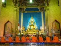 Evening chant in Marble temple. BANGKOK - APRIL 16: Monk come together in hall of main church of Marble temple for evening chant front of The main Buddha statue Stock Images