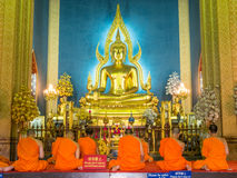 Evening chant in Marble temple. BANGKOK - APRIL 16: Monk come together in hall of main church of Marble temple for evening chant front of The main Buddha statue Stock Image