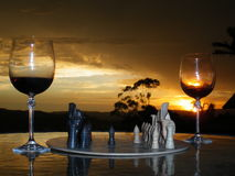 An Evening of Chess and Wine. A game of chess a glass of red with a glorious sunset Stock Images