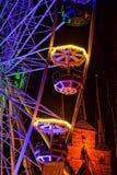 Evening Christmas market, colorful carousel. Stock Image