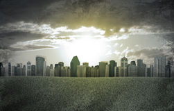 Evening city. Buildings and green grass field. Grunge style Royalty Free Stock Photography