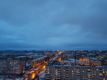 Evening city. Evening lights of houses and streets Royalty Free Stock Images