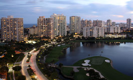 Evening City - Miami Florida. Evening view overlooking Miami golf course, condos, streets, and ocean Stock Photography