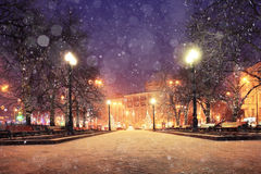 Evening city with snow Royalty Free Stock Photos