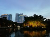 Evening city view from lakeside, Kuala Lumpur stock photography
