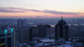 Evening city view on the sunset background. Time-lapse stock video footage