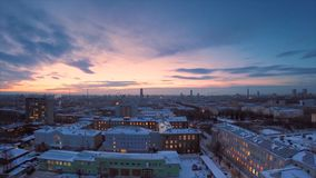 Evening city in winter timelapse. Evening city in winter view from roof timelapse. Panoramic view on the town and roofs Stock Images
