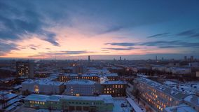 Evening city in winter timelapse. Evening city in winter view from roof timelapse. Panoramic view on the town and roofs Stock Image