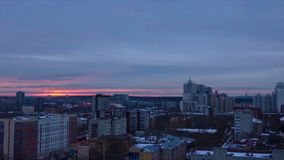 Evening city in winter timelapse. Evening city in winter view from roof timelapse. Panoramic view on the town and roofs Royalty Free Stock Photos
