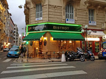 Evening cityscape with french outdoor cafe bistrot in Nice, Fran. NICE, FRANCE - MAY 16, 2013:  Evening cityscape with french outdoor cafe bistrot in Nice, the Stock Image