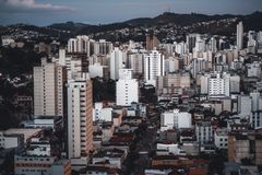 Evening cityscape of Juiz de Fora, Brazil. Close-up view from a high point of a dark evening urban landscape with the street in the center of the shot, multiple Stock Photography