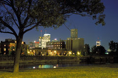 Evening cityscape in Montreal. Evening cityscape in Old Montreal showing lighted buildings, industrial silos and de Lachine Canal stock photography
