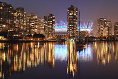 Evening CityScape of Vancouver BC. False Creek view of Yaletown district highrise buildings an BC Stadium, reflecting at the waters of the False Creek Royalty Free Stock Photos