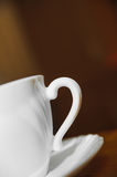 Evening classical white cup of tea on a blur backgrounds Stock Image