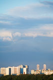Evening cloud over urban district in summer sunset Royalty Free Stock Photos