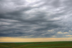 Evening clouds above the ground. Fields Stock Photo