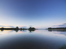 Evening clouds above lake Royalty Free Stock Image