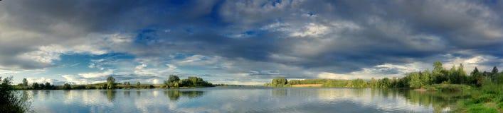 Evening clouds above lake Stock Photos