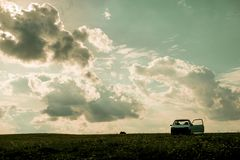 Evening clouds, car on a sunset background, nobody. Ural landscape, Russia.  Royalty Free Stock Image
