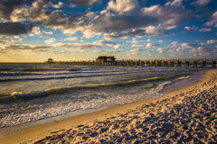 Evening clouds over the fishing pier and Gulf of Mexico in Naple Stock Image