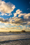 Evening clouds over the fishing pier and Gulf of Mexico in Naple Stock Photos