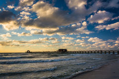 Evening clouds over the fishing pier and Gulf of Mexico in Naple Stock Images