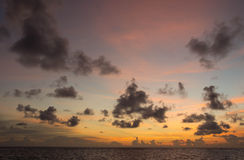 Evening cloudy sky over the ocean Royalty Free Stock Photo