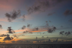 Evening cloudy sky over the ocean Royalty Free Stock Image