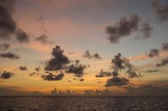 Evening cloudy sky over the ocean Stock Photo