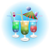 Evening  cocktails. Three cocktails with straws and umbrellas are next to each other Royalty Free Stock Photo