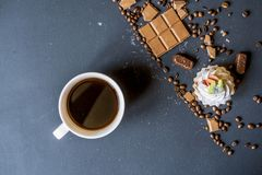 Evening coffee with sweets and biscuits on dark table f stock photography