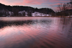Evening color on the lake. Colorful evening on the lake in swiss Alps royalty free stock photo