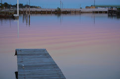 Evening Colors at the Marina. Evening colors reflecting off the water in Palacios, Texas royalty free stock photography
