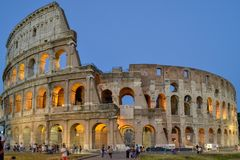 Evening Colosseum surrounded by tourists stock images