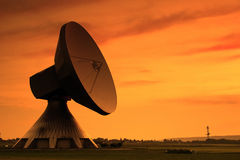 Evening Communication. Huge Satellite Dish in the Evening Sun Royalty Free Stock Image