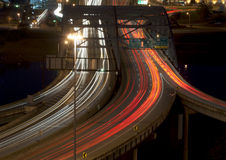 Evening Commute. In Charleston, West Virginia on bridge over Kanawha River at night. Long exposure for motion blur and car streaks Stock Photo