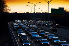 Evening commute traffic. Traffic caught up in evening commute at sunset Stock Image