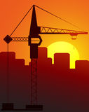 Evening construction cran. Construction crane against the evening city Stock Images