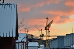 Evening on the a construction site of the industrial city Royalty Free Stock Photography