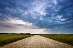 Evening country road with dramatic sky Stock Photography