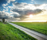 Evening country road with dramatic sky Royalty Free Stock Images