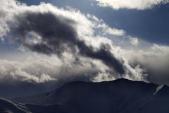 Evening dark mountain and sunlight clouds Royalty Free Stock Photography