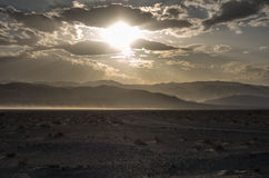 Evening in the Desert. Wind, clouds and sun in the Death Valley Royalty Free Stock Photo
